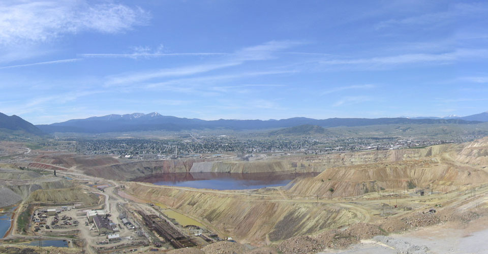 Looking south toward Butte, Montana over the Berkeley Pit, from the Yankee Doodle Tailings Pond dam