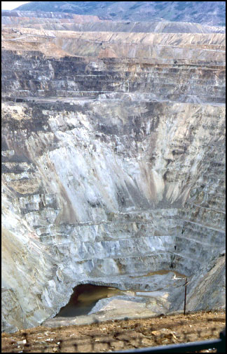 The Berkeley Pit in 1982. The water seen here is surface runoff flowing into the Leonard mine shaft to the right at the Pit bottom.