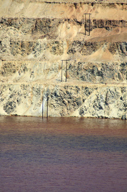 Berkeley Pit water quality has shown changes over time. It is regularly monitored by the Montana Bureau of Mines & Geology. The reddish color typically observed is due to high concentrations of iron solids. Photo by Justin Ringsak, 2009.