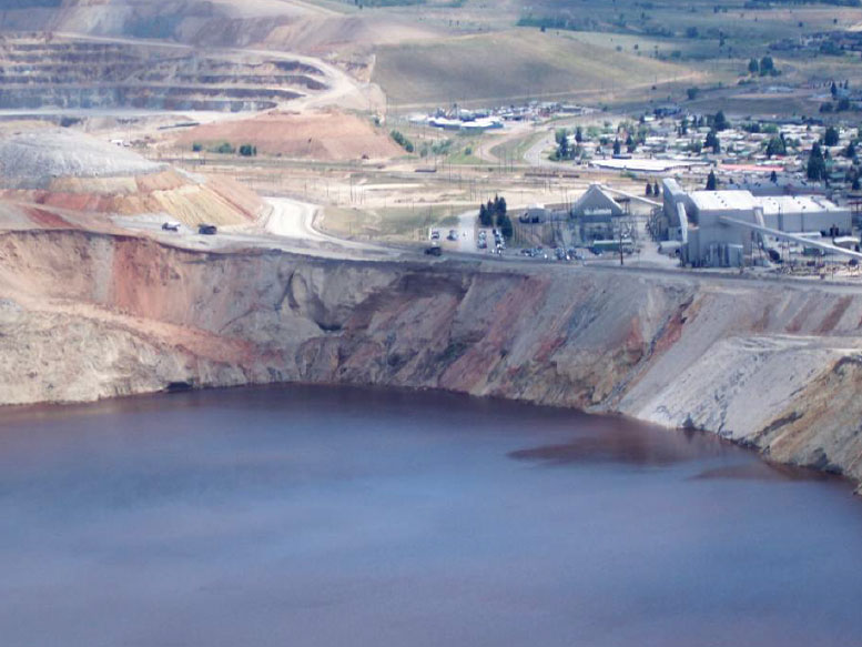 This photo from July 2013 shows the rim of the Berkeley Pit were a slough deposited surface material into the Pit lake in Feb. 2013. Photo by Fritz Daily.