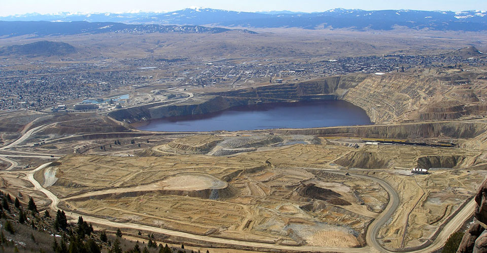 The Berkeley Pit looking west from Rampart Mountain near Butte, Montana. The Pit water and connected underground mines and wells are monitored monthly by the Montana Bureau of Mines & Geology. Photo by Matt Vincent.